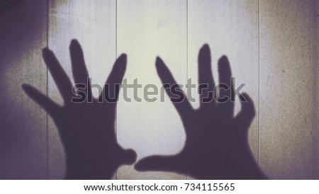 Silhouette of hand women on the wall to show ghost and horribleness halloween concept