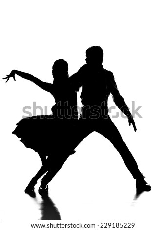 Silhouette of handsome couple of professional dancers on the grey background. Passionate dance. - stock photo