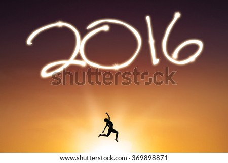 Silhouette of happy woman leaps on the air while celebrating new year of 2016, shot at sunset time - stock photo
