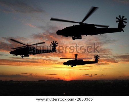 Silhouette of helicopters over sunset