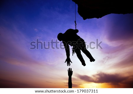 Silhouette of helping hand between two climber