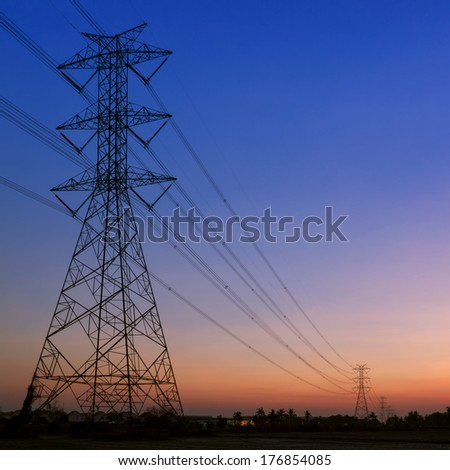 Silhouette of high voltage electric pole Sunset skyline - stock photo