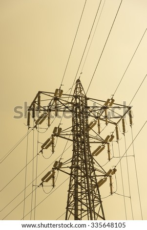 silhouette of high voltage electric tower with beautiful sky background