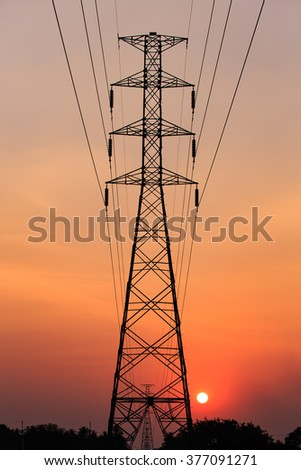 silhouette of high voltage electric tower with beautiful sunset