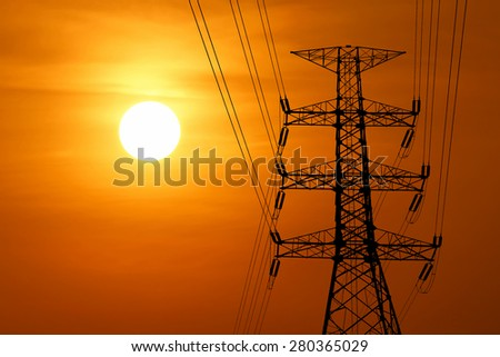 silhouette of high voltage electric tower with beautiful sunset  background - stock photo