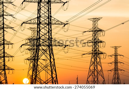 silhouette of high voltage electrical pole structure - stock photo