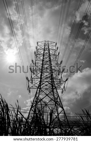 Silhouette of high voltage post - black and white - stock photo