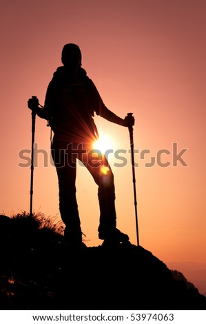 silhouette of hiker in the mountains - stock photo