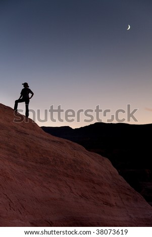 Silhouette of hiker with moon.