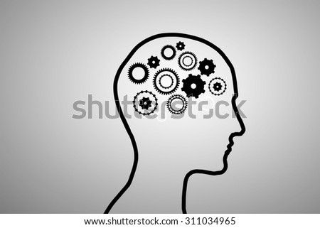 Silhouette of human head with gears mechanism instead of brain
