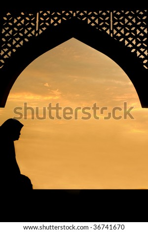 silhouette of islamic women in traditional dress with islamic architecture - stock photo