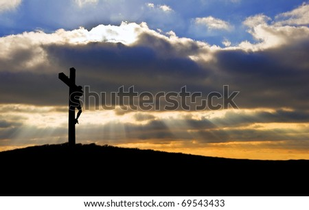 Silhouette of Jesus Christ crucifixion on cross on Good Friday Easter - stock photo