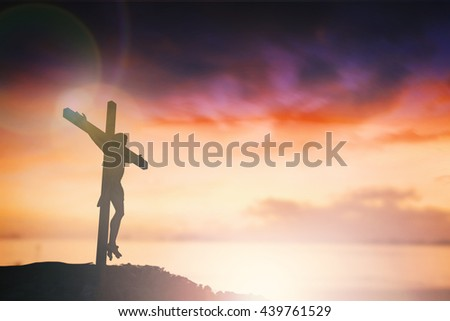 Silhouette of Jesus with Cross over sunset concept for religion, worship, Christmas, Easter, Redeemer Thanksgiving prayer and praise. revelation son happy world 2017