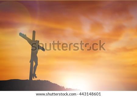 Silhouette of Jesus with Cross over sunset concept for religion, worship, Christmas, Easter, Redeemer Thanksgiving prayer and praise. revelation son happy world 2017 Baptist new old john god - stock photo