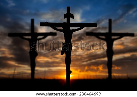 Silhouette of Jesus with Cross over sunset concept for religion worship Christmas Easter Redeemer Amazing grace prayer and praise Thanksgiving dramatic sky vintage redeemer life  - stock photo