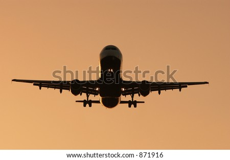 Silhouette of jet on final approach