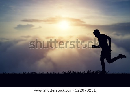 silhouette of jogger in sunset