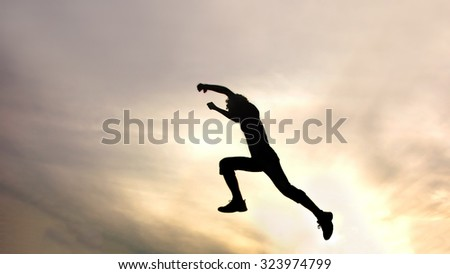 silhouette of jumping boy against sky. Header for website - stock photo