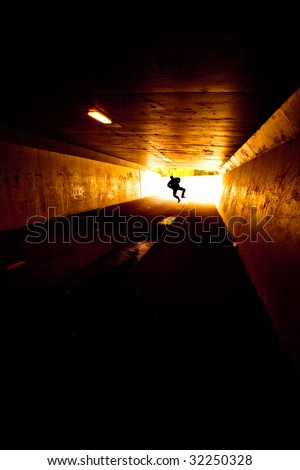 Silhouette of Jumping man - stock photo