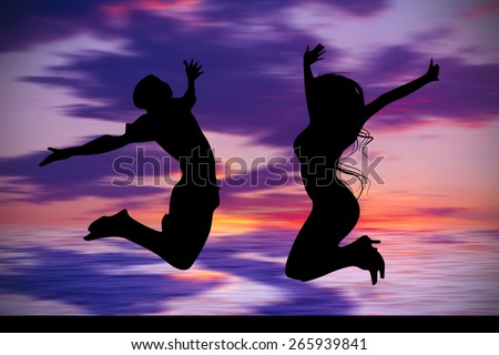 Silhouette of jumping teenagers with sunset sky background - stock photo