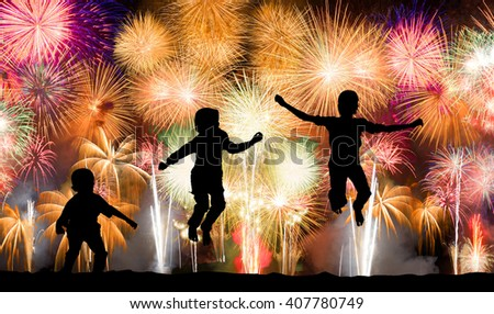 Silhouette of kids jumping over colorful firework - stock photo
