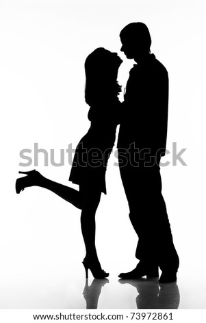 Silhouette of kissing happy couple. Ready for your logo. Isolated on white background