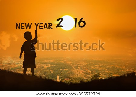 Silhouette of little boy  see sunset new year 2016 - stock photo