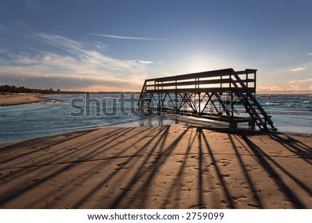 Silhouette of little bridge on a background of a sunset - stock photo