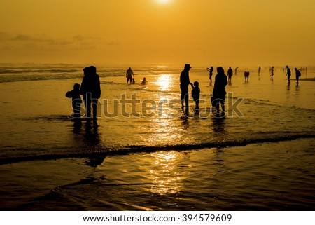 Silhouette of local people enjoying at beach.