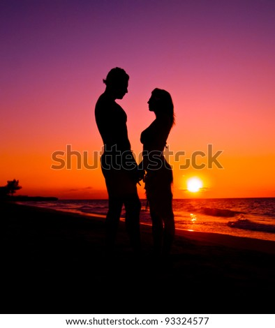 Silhouette of Lovely Couple at the beach - stock photo