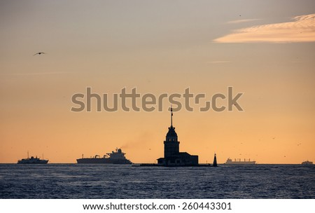 Silhouette of Maiden's Tower and ships in Bosporus sea channel, Istanbul - stock photo