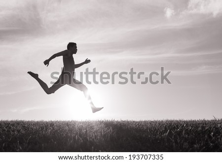Silhouette of male running.