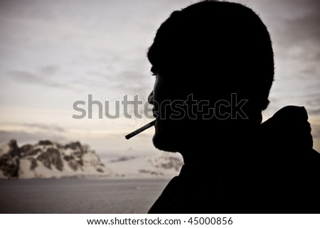 Silhouette of male smoker
