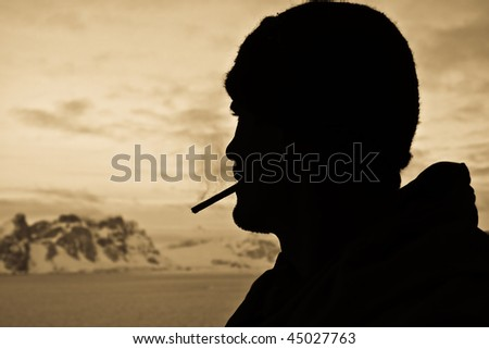 Silhouette of male smoker - stock photo