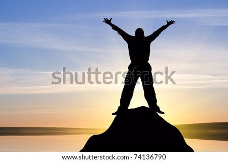 silhouette of man against the sky - stock photo