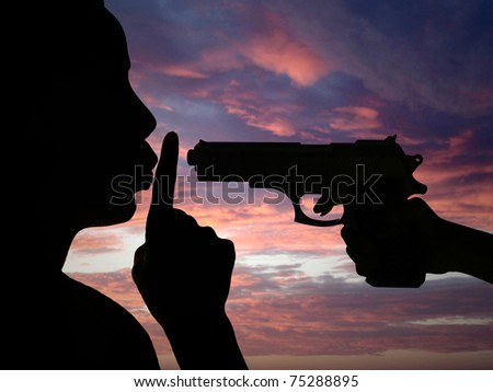 Silhouette of man against the war - stock photo