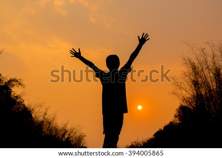 Silhouette of man and beautiful sunset sky