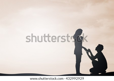 silhouette of man ask woman to marry on sky sepia color tone background:teen couple in love concept:dark shadow people lovers in romantic and happy moment time.Valentine's day:sepia color tone effect - stock photo