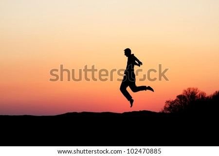 silhouette of man dancing in sunset