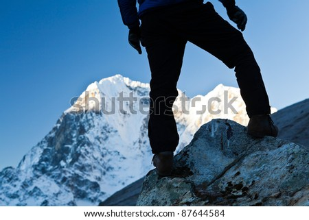 Silhouette of man hiking in Himalaya Mountains in Nepal - stock photo