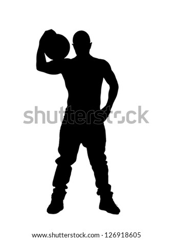 Silhouette of man holding ball in his shoulder - stock photo