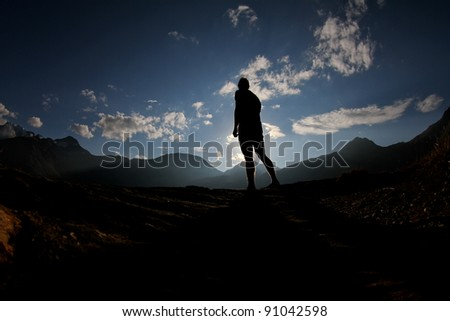 silhouette of man in swiss alps