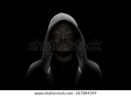 Silhouette of man in the hood - stock photo