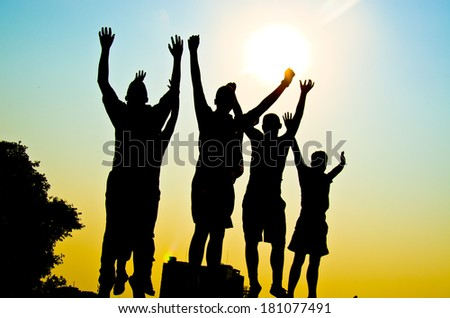 silhouette of man jumping for happy together