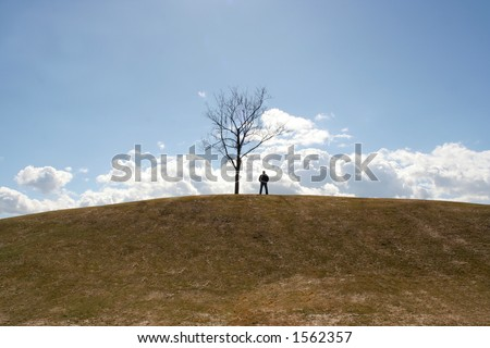 Silhouette of man on cloudy background - stock photo