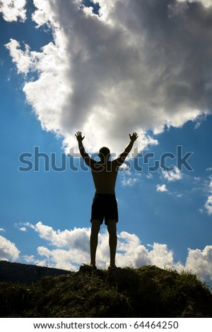 Silhouette of man  on sky background. - stock photo