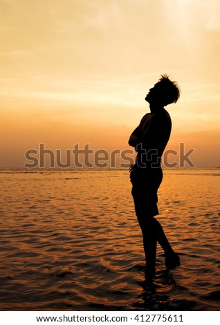 Silhouette of Man on the beach. - stock photo