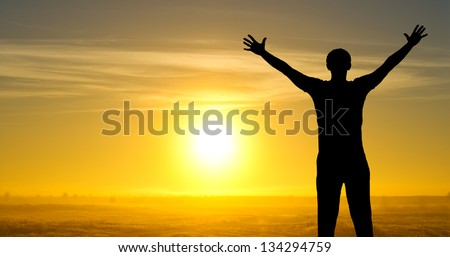 Silhouette of man on the field in the morning
