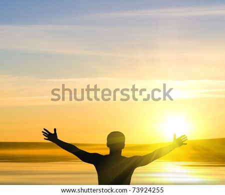 silhouette of man on the sunrise - stock photo