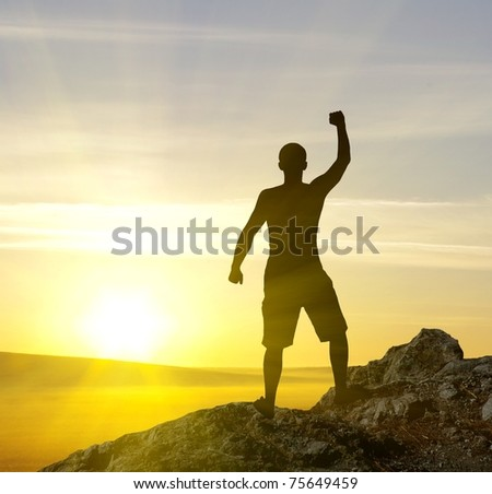 silhouette of man on the sunset - stock photo
